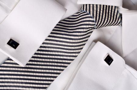 White shirt , elegant necktie and blue cufflinks