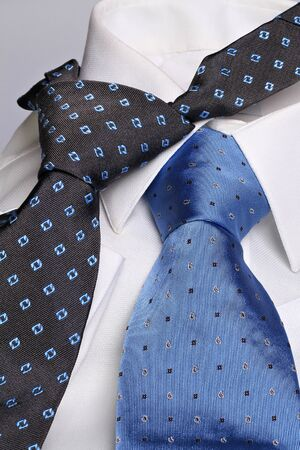 White shirt with two  elegant cyan and blue neckties   photo