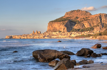 Cefalu rock and historical town . Sunset light