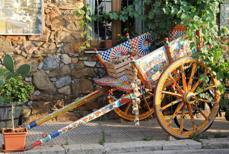 Painted traditional sicilian cart with garlic boxes