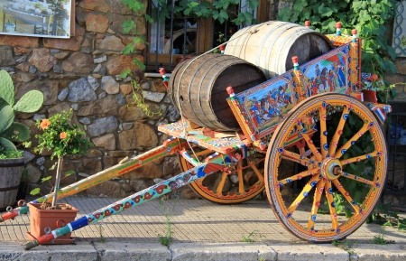 Traditional coloured sicilian cart with 2 wooden barrels