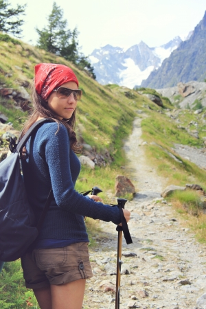 aosta: Hiking girl on high mountain trail in Aosta Valley