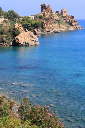 Cefalu coastline in mediterranean sea with old tower of stone   Sicily