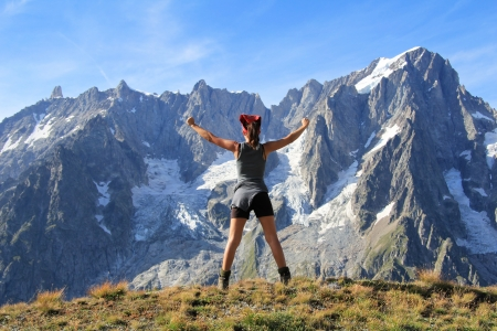 Hiker woman happy and successful  in front of  Grand Jorasses and Mont Blanc panorama   Ferret Valley , Courmayeur , Italy  photo