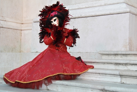 Beautiful venetian mask woman posing on marble stairs of Saint George Isle church  photo