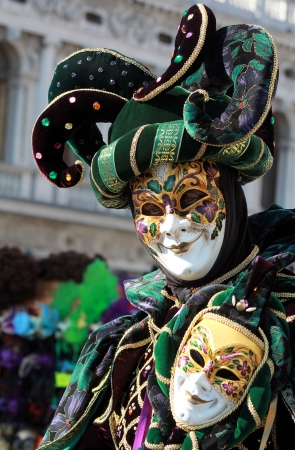 Elegant green and purple jester  with velvet dress. Venice carnival 2012