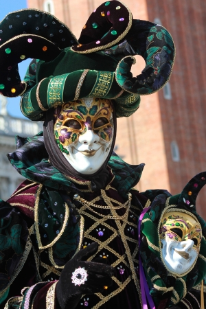 Funny gaze on the green joker mask. Venice carnival 2012