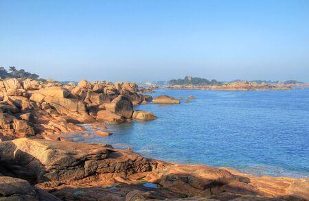 granit: Big rocks of pink granit in Ploumanach coast , Brittany , France