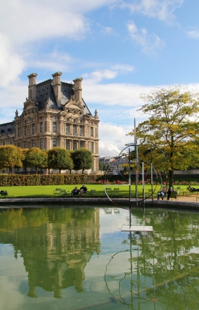 palace in tuileries garden reflected in a pond jardins des tuileries paris stock photo - Jardins Des Tuileries