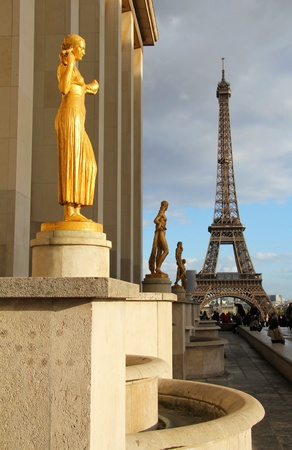 trocadero: Golden statue in Trocadero lighted by sunset, Eiffel tower silhouette in background