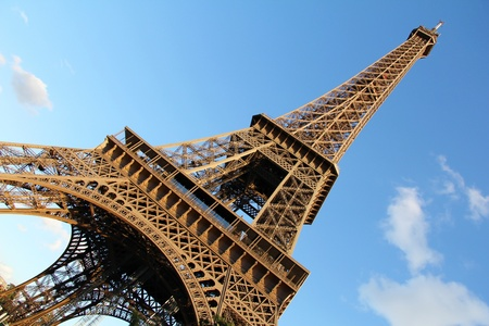 Diagonal view of Eiffel Tower against a blue clean sky . Paris , France photo