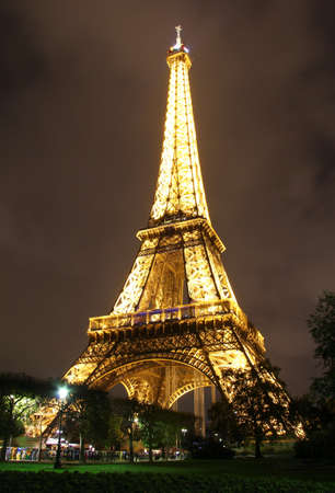 Famous Eiffel Tower , lighted structure in the night   Paris , France