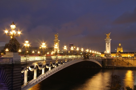 invalides: Pont Alexandre III and Hotel des Invalides at evening. Paris nightscenes