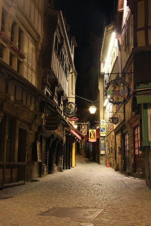 Medieval road at Mont Saint Michel at night , used during history by the plilgrims to reach the abbey.