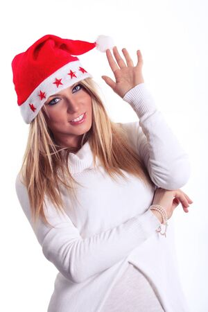 santa girl: Beautiful Christmas young woman. Smiling girl poses with her  Santa Claus hat