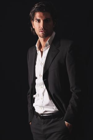 Handsome model in elegant dress   Low key light portrait Standard-Bild