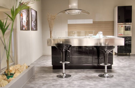 Modern kitchen with steel table and cooking platform. Stylish and elegant