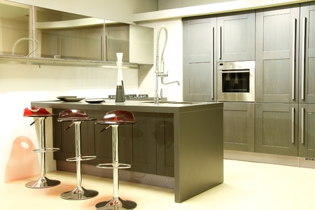 Modern steel and grey kitchen , sink and mirrors . Grey colour wooden closet.