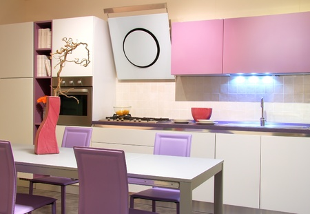 Modern kitchen in soft pink and cream colours