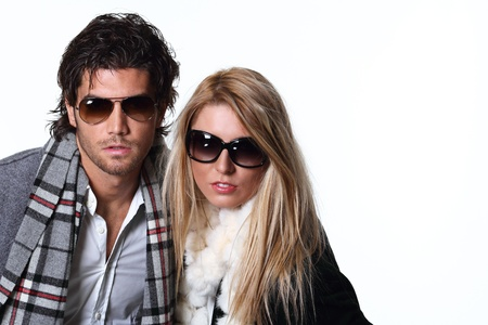 Couple of fashion models with sunglasses. Studio shot photo
