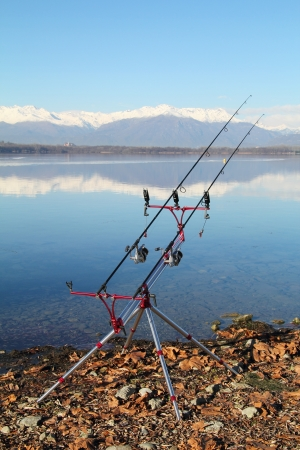 Fishing equipment and rods with beautiful landscape as background Stock Photo - 16828430