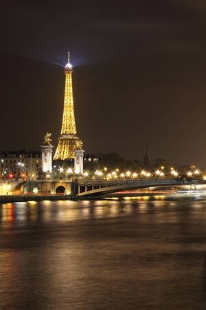 Alexander III bridge illuminated and wonderful Eiffel tower . Paris at night