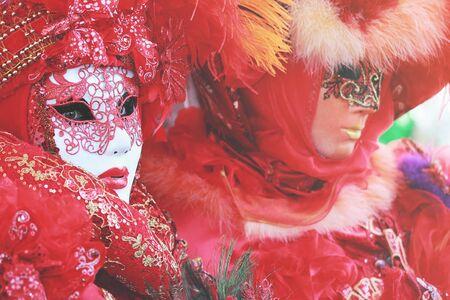 velvet dress: Red venetian mask at Venice