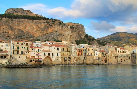 Sicilian town of Cefalu at sunset. Old Harbour and town  photo