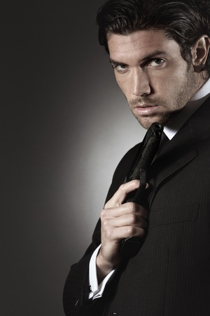 Portrait of an handsome model with a gun. Secret agent or bodyguard concept  Stock Photo
