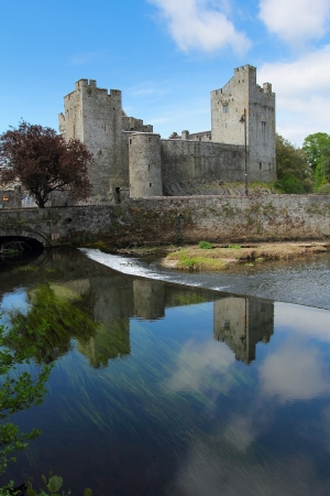 county tipperary: Cahir castle reflected in the river , Tipperary county , Ireland  Editorial