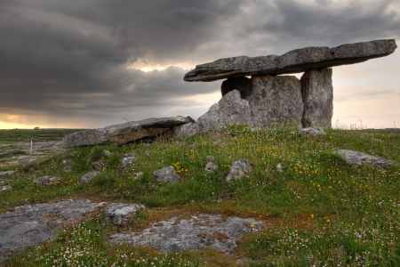 megalith: Poulnabrone Dolmen in cloudy sunset light . Clare county , Ireland  Stock Photo