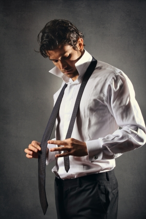 Handspme model wearing black tie . Fashion or businessman concept