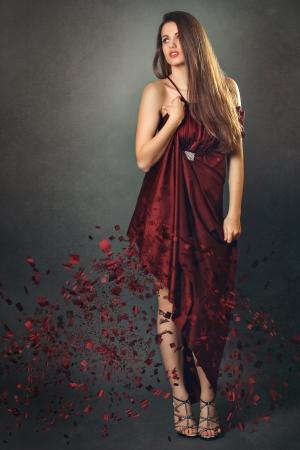 fine art portrait: Elegant model  with creative eroded effect on silk dress. Fine art portrait