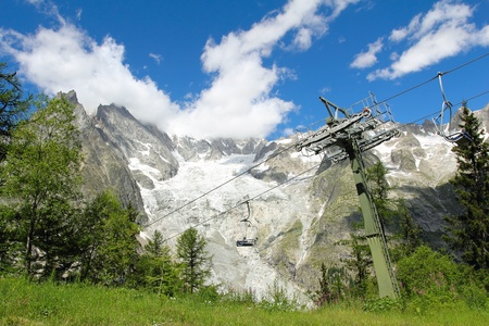 veny: Chair lift in Veny valley with Mont Blanc massif and glacier in background   Aosta Valley , Italy