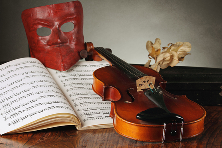 comedic: Venetian mask with old violin and music notes   Carnival and theater concept Stock Photo