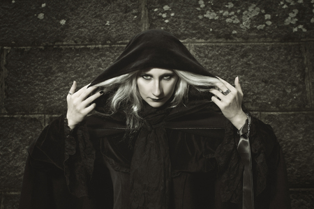 incubus: Portrait of a dark witch against a stone background. Halloween and horror.