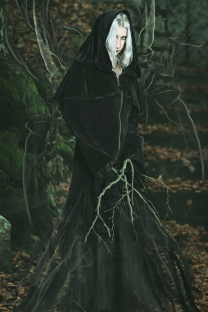 emanation: Dark powers emanation from forest witch. Halloween and fantasy Stock Photo