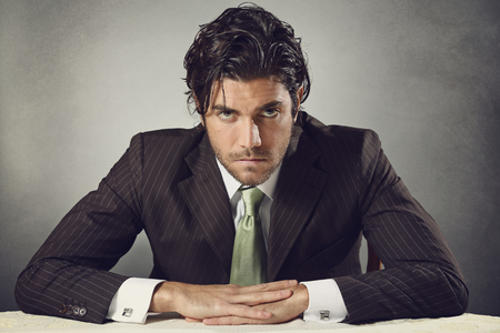 resolute: Handsome businessman with resolute expression and deep gaze