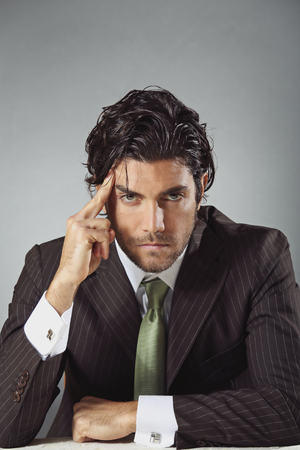 Handsome businessman with pensive expression and pose. Problem solving concept photo
