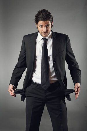 empty pockets: Businessman shows empty pockets. Financial crisis concept