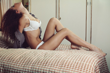 boudoir: Beautiful lingerie model posing on the bed . Boudoir and sensual Stock Photo