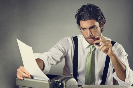 Handsome writer with pipe focused on his letter . Texture background Standard-Bild