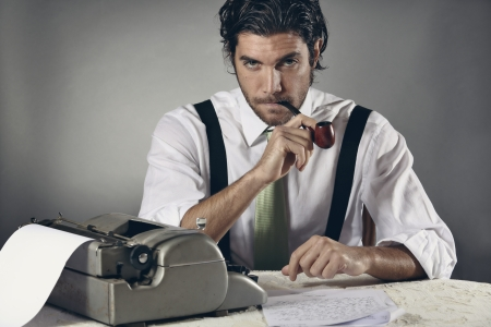 Portrait of an handsome journalist with pipe and typewriter Stock Photo - 24399166