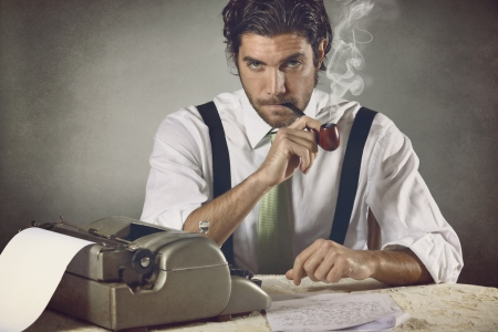 Vintage portrait an handsome writer smoking the pipe Stock Photo - 24399167