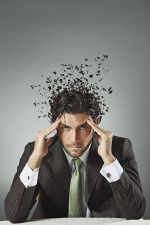 scattered: Handsome businessman with scattered mind. Stress and confusion conceptual Stock Photo