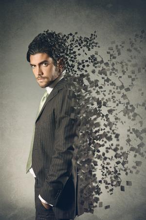 Artistic erosion effect on handsome businessman   Grey textured backdrop