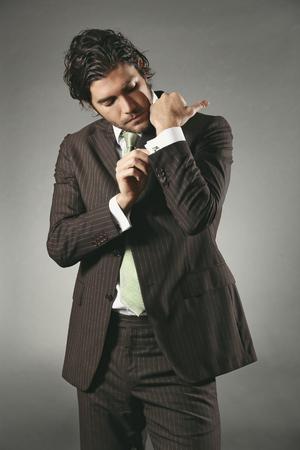 cufflinks: Handsome model wearing cufflinks . Fashion or businessman concept