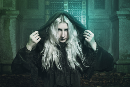 incubus: Black dressed witch and magical lights. Halloween and horror. Stock Photo