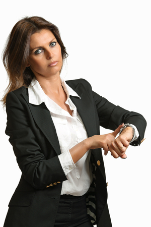 strict: Manager woman with strict expression touch her watch . Delay conceptual Stock Photo
