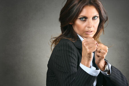 Aggressive and fighting manager woman  . Business competition concept Stock Photo